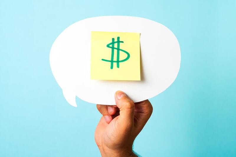 hand raising money sticky note in chat bubble