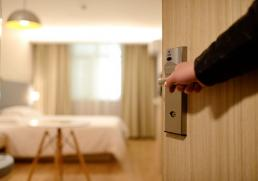showing a customer their hotel room