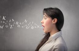 girl with mouth open and letters coming out