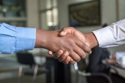 two make workers shaking hands