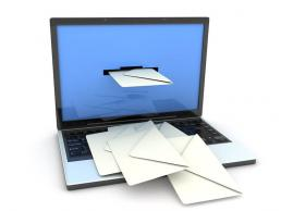 envelopes being delivered through a laptop screen