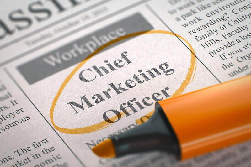 newspaper with job ad for a chief marketing officer